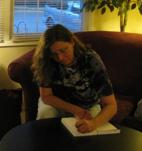 That's me, signing my first book...