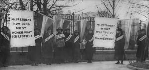 Women suffragists picketing in front of the White house. The first picket line - College day in the picket line line, 1917 via Library of Congress.