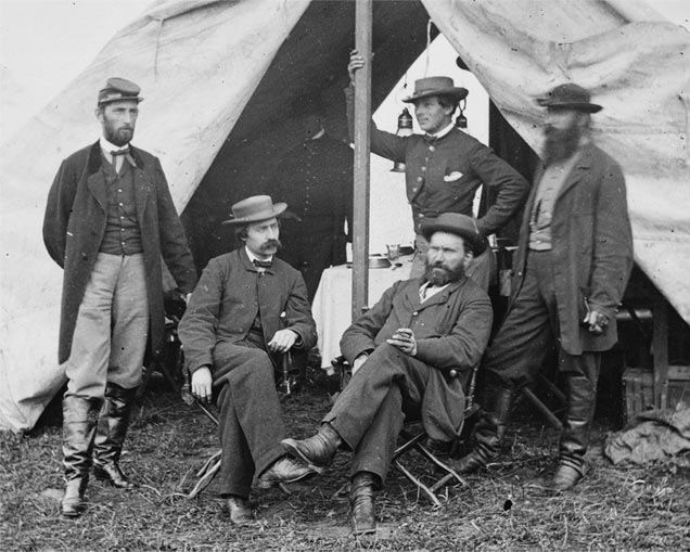 Allan Pinkerton (seated, right) at Antietam. The beardless man is thought to be Kate Warne in disguise. Image via Library of Congress, n.d.