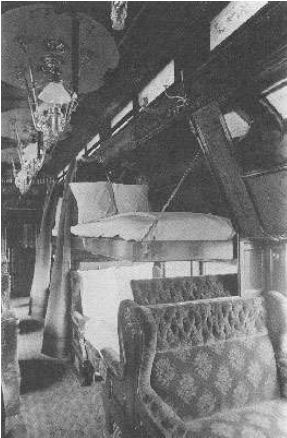 Sleeper car, bunk pulled down. Image from the Pullman Company, 1890s.