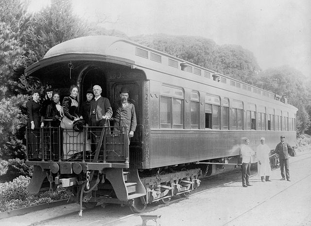 Henry M. Stanley and party standing on back of train at Monterey, California, March 19th, 1891, porters standing at side of car. Library of Congress.
